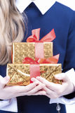 Closeup of Hands of Little Caucasian Girl With Christmas Present Royalty Free Stock Photography