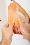 Closeup of hands massaging foot Stock Photos