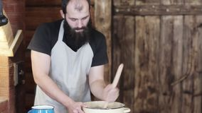 Closeup of the hands of men to knead the dough for baking bread stock video