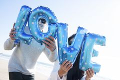 Letter-shaped balloons forming the word love Royalty Free Stock Photos