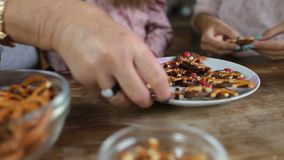 Hands taking homemade cookies from the plate stock footage