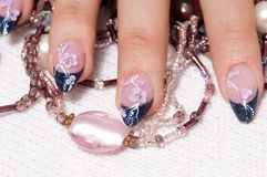 Closeup hands nail art with jewel Stock Images