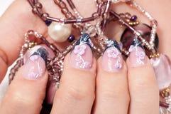 Closeup hands nail art with jewel Stock Photography