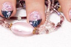 Closeup hands nail art with jewel. Closeup hands nail art zone. Pink and blue with jewel. High resolution Royalty Free Stock Image