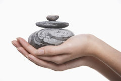 Closeup Of Hands With Pile Of Stones Royalty Free Stock Photos
