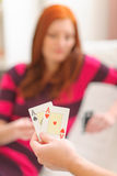 Closeup on hands with playing cards Stock Photography