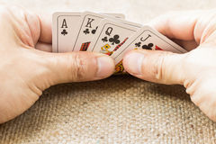 Closeup of hands with playing cards stock image