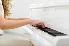 Closeup of hands playing piano Royalty Free Stock Image