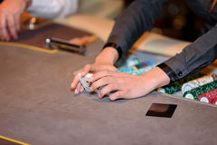 Closeup of hands of poker croupier with cards in casino, selecti. Closeup of hands of poker croupier with cards in casino Royalty Free Stock Photography