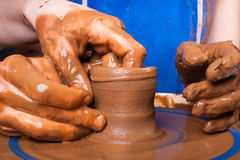 Closeup of hands of potter teaching how make clay pot Stock Photos