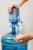 Closeup of hands pouring water into glass from bottle stock images