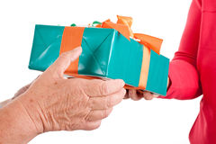 Closeup, hands reaching each other a gift Royalty Free Stock Images