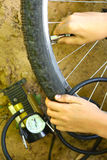 Closeup hands repairing a flat tire use compressor Royalty Free Stock Images