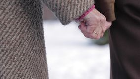 Closeup hands of seniors people. Male and female. Couple. Grandpa and grandma. Love forever