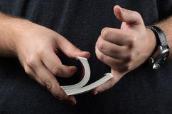 Closeup of hands shuffling cards Royalty Free Stock Photo