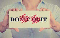 Closeup hands sign don't quit do it message Royalty Free Stock Photo
