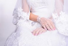 Closeup hands of sitting bride Stock Photo