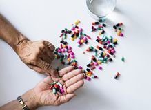 Closeup of hands taking pills health treatment isolated stock image