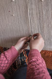 Closeup hands weaving carpet Stock Images