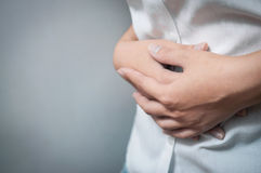 Closeup of hands of  woman have a stomachache. Stock Image