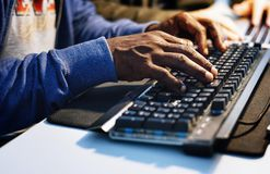 Closeup of hands working on computer keyboard stock images