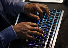 Closeup of hands working on computer keyboard stock image
