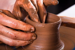 Closeup of hands working on pottery wheel Royalty Free Stock Images