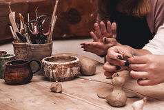 Closeup of hands working on pottery wheel Royalty Free Stock Photography