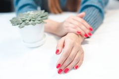 Closeup of hands of a young woman with red manicure royalty free stock photos