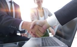 Closeup.handshake financial partners i. N the workplace royalty free stock images