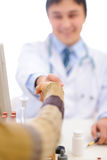 Closeup on handshake of medical doctor and patient Stock Images