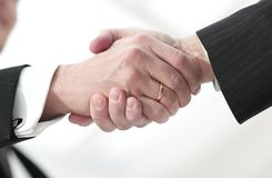 Closeup handshake proven business partners Stock Images