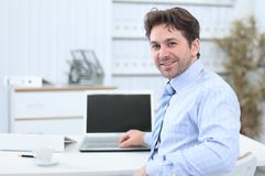Closeup.handsome businessman sitting in this Desk Royalty Free Stock Photography