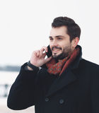 Closeup handsome elegant man talking on the smartphone Stock Photos