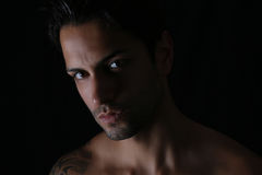 Closeup of an handsome man. On a black background Royalty Free Stock Photo