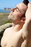 Closeup of handsome muscular man taking sunbath Royalty Free Stock Images