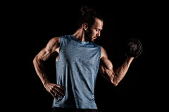 Closeup of a handsome power athletic man bodybuilder doing exerc Stock Photography