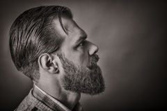 Closeup of a handsome young man with retro look, side view Stock Photos