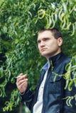 Closeup handsome young man smoking cigarette Stock Photo