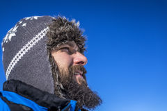 Closeup of handsome young man with winter hat looking away Stock Photography