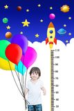 Closeup happy asian kid hold colorful balloon with measure height and cute cartoon background Royalty Free Stock Images