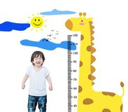 Closeup happy asian kid stand for measure height with cute cartoon isolated on white background stock images