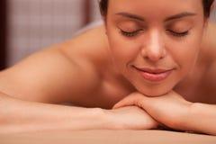 Young woman enjoying professional massage royalty free stock photo