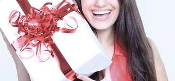Closeup. happy beautiful woman kissing her a gift. Stock Image