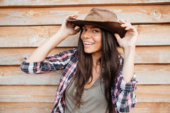 Closeup of happy beautiful young woman cowgirl in hat Stock Images