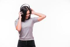 Closeup of happy brunet caucasian  girl listen dancing to music with headphones Stock Image