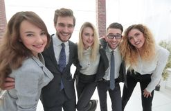 Closeup.happy business team looking at camera. Happy business team looking at camera. the concept of teamwork Stock Image