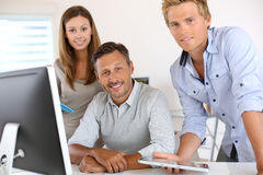 Closeup of happy business team working together Royalty Free Stock Photo