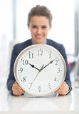 Closeup on happy business woman with clock Royalty Free Stock Photo