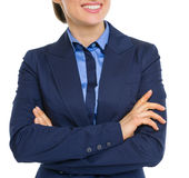 Closeup on happy business woman with crossed hands Royalty Free Stock Image